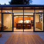 Broadview Residence Remodel/Addition of a mid-century home. Indoor/Outdoor space is formed by the use of a commercial storefront window system with large sliding doors. Concrete flooring with radiant heat extend from inside out. Flush IPE decking in the concrete patio further delineate the outdoors